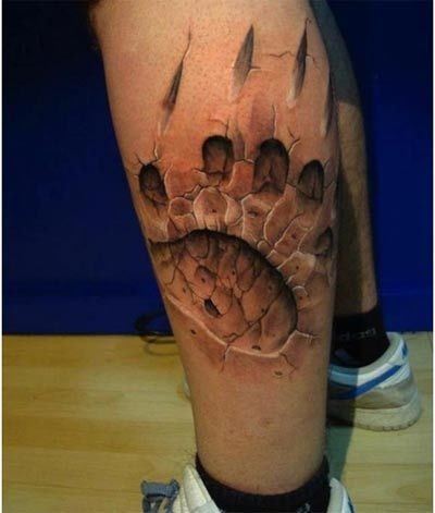 Cool 3d bear paw print tattoo on leg