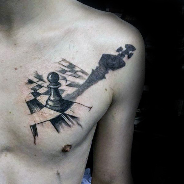 Cool looking black ink chest tattoo of small chess figure