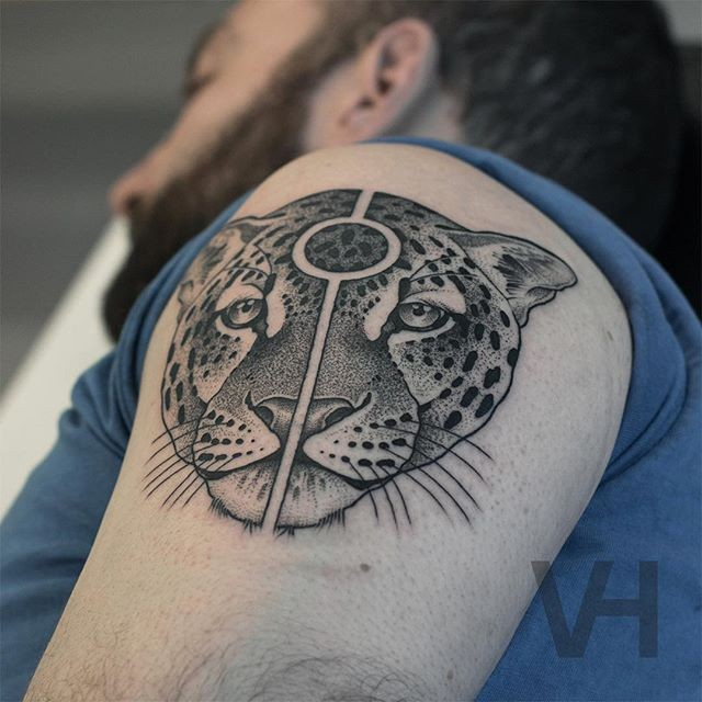 Cool symmetrical painted shoulder tattoo of leopard head with original sign