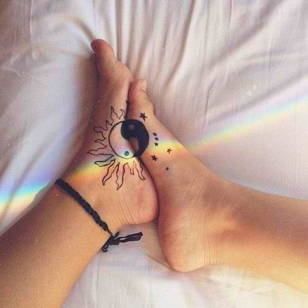 Couple black and white feet tattoo of Yin Yang symbol