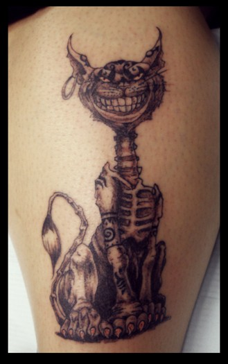 Crazy cat skeleton with earring in ear tattoo