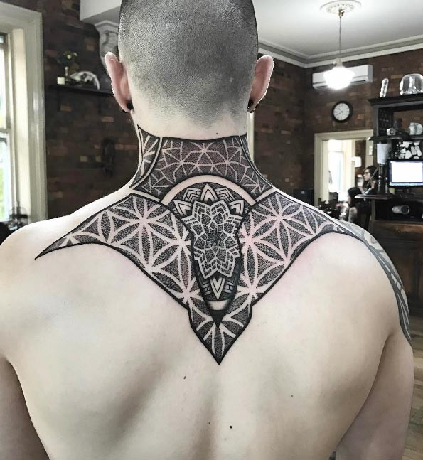 Creative dot style upper back tattoo of enormous ornament