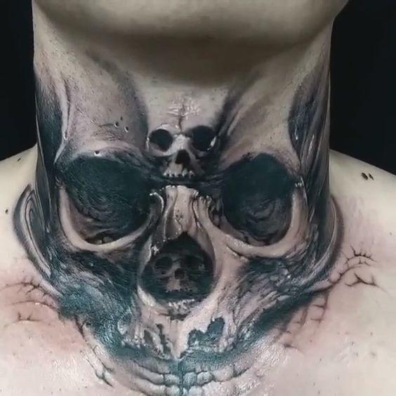 Creepy looking 3D style throat tattoo of demonic human skull