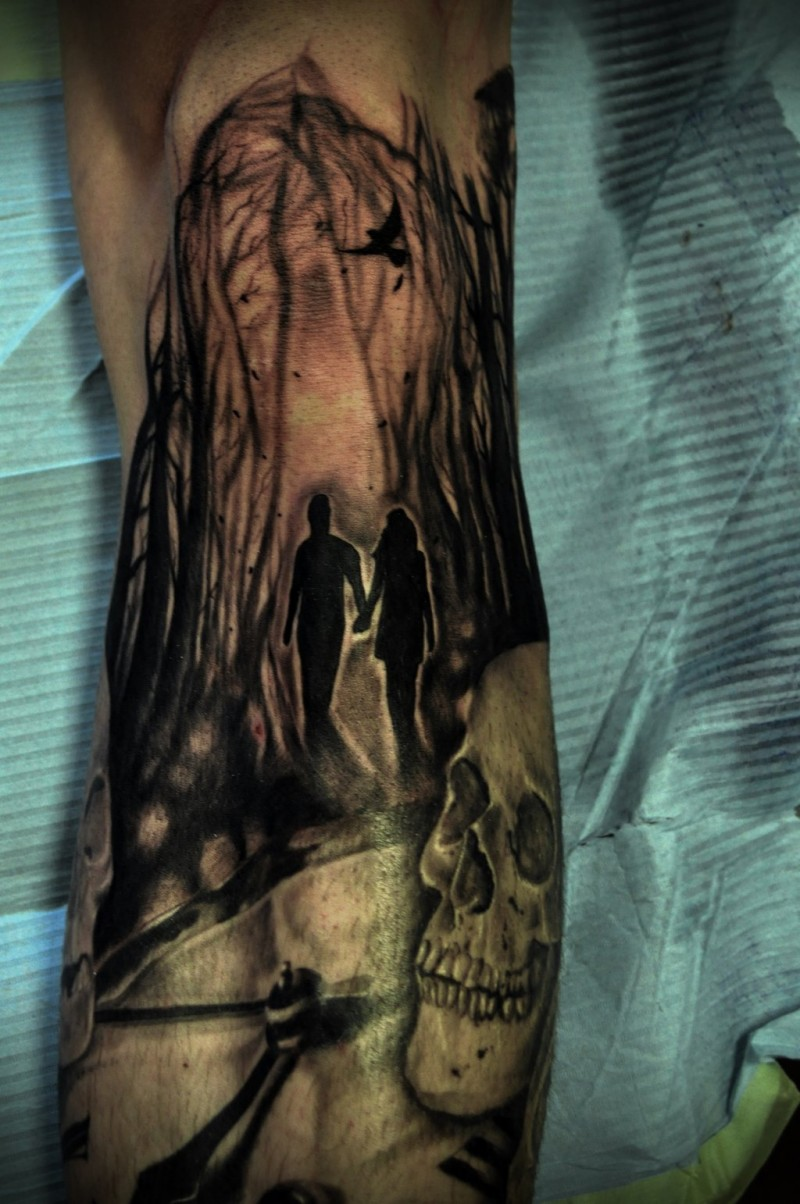 Creepy looking black and white half sleeve tattoo of people in dark forest with skull