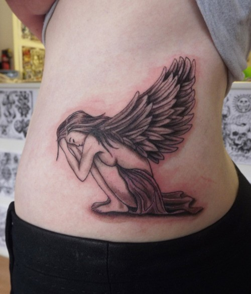 Crying angel girl tatoo on side of stomach