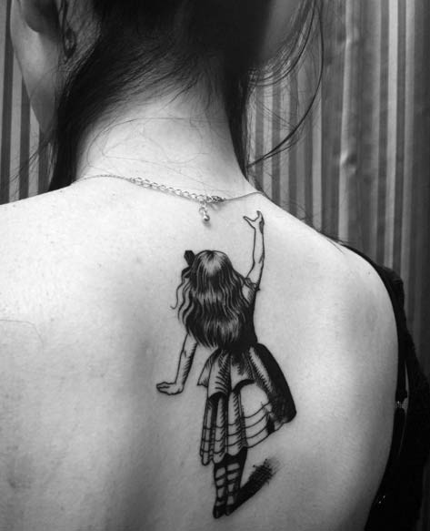 Cute black and white fairy tale girl tattoo on lady's upper back