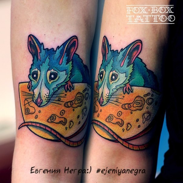 Cute cartoon style colored arm tattoo of little mouse with cheese