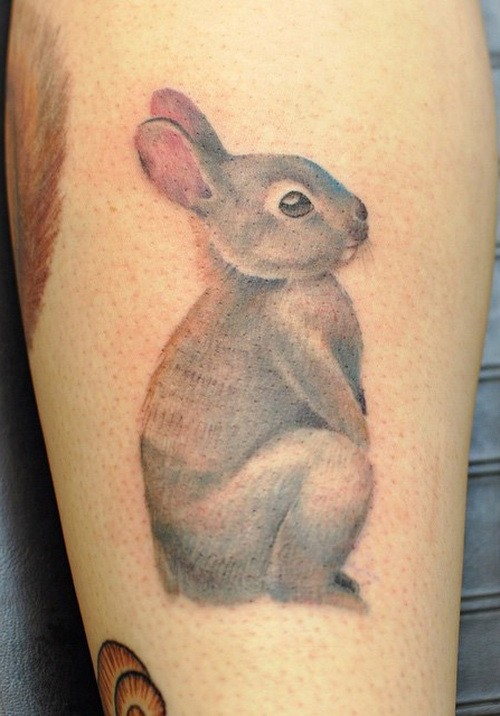 Cute girly gray hare tattoo on shin