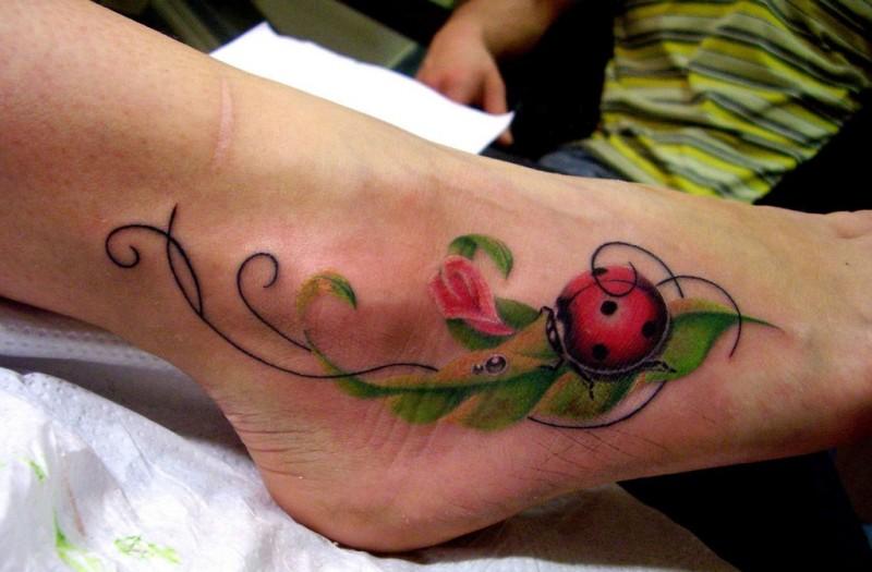 Cute ladybug foot tattoo with leaves