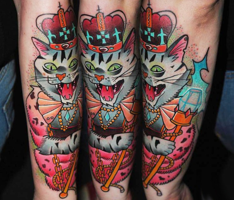 Cute looking cartoon style arm tattoo of king cat with diamonds