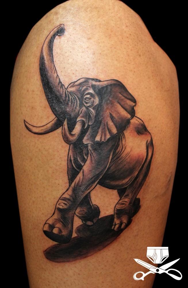 Cute looking colored cartoon style tattoo of walking elephant