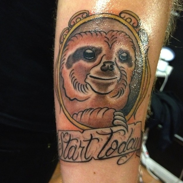Cute simple painted and colored sloth portrait with lettering tattoo on arm