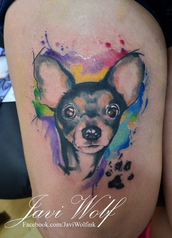 Cute small dog's portrait with paw print tattoo with colored paint drips in watercolor style on thigh by Javi Wolf