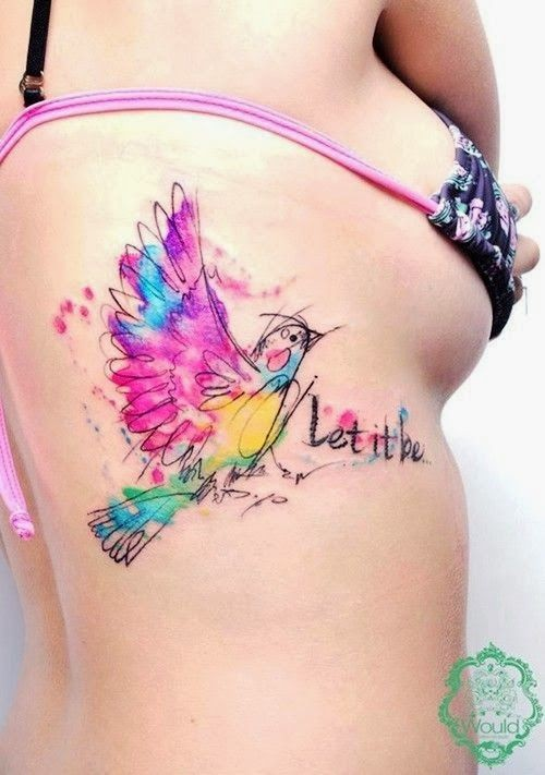Cute watercolor bird tattoo on ribs