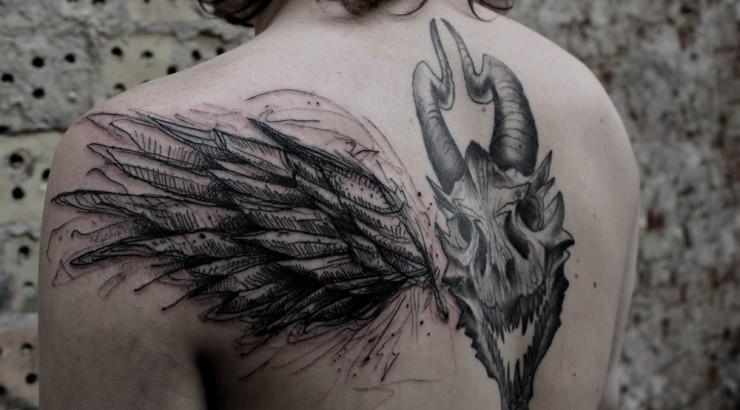 Dark black ink demonic goat skull with wing