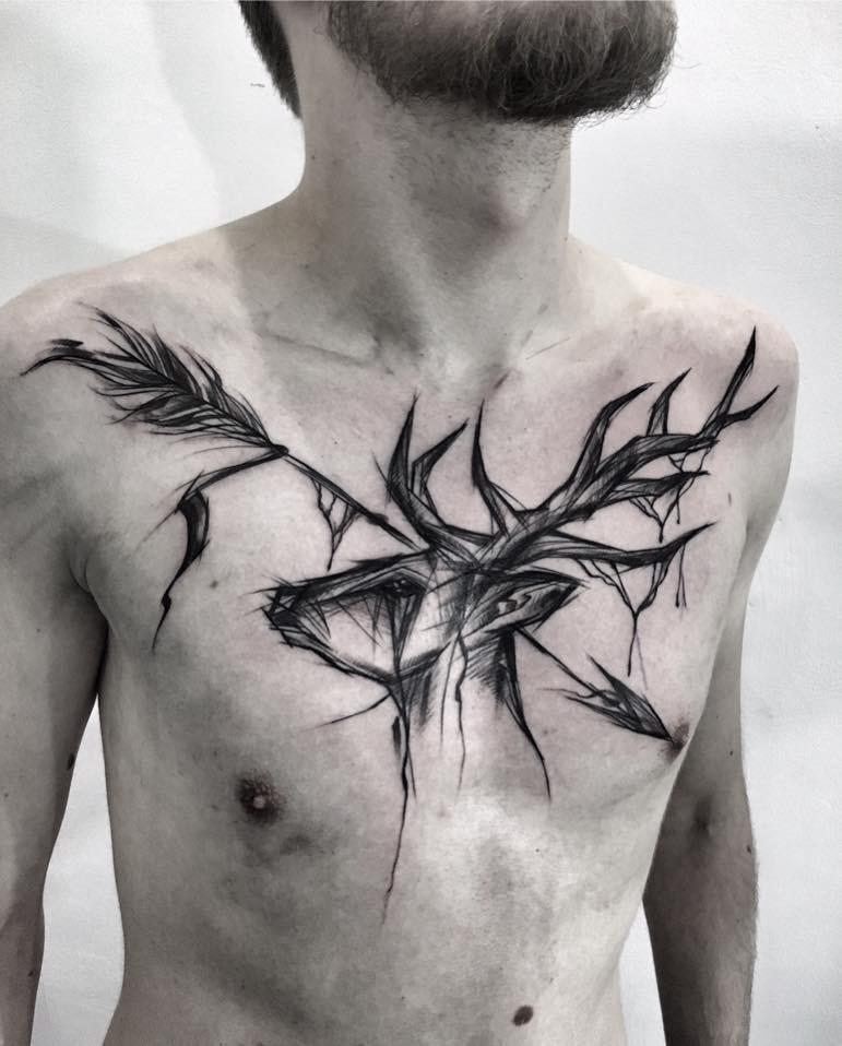 Designed by Inez Janiak black ink chest tattoo of deer with big arrow