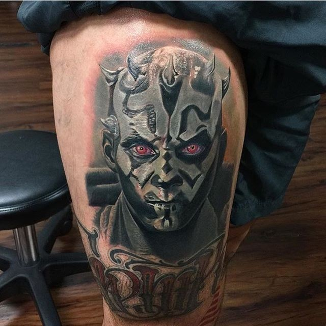 Detailed and colored thigh tattoo of Star Wart Darth Moll