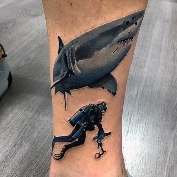 Detailed creative painted leg tattoo of diver with large shark