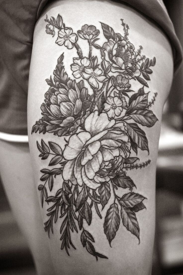 Detailed floral tattoo on hip by Alice Carrier