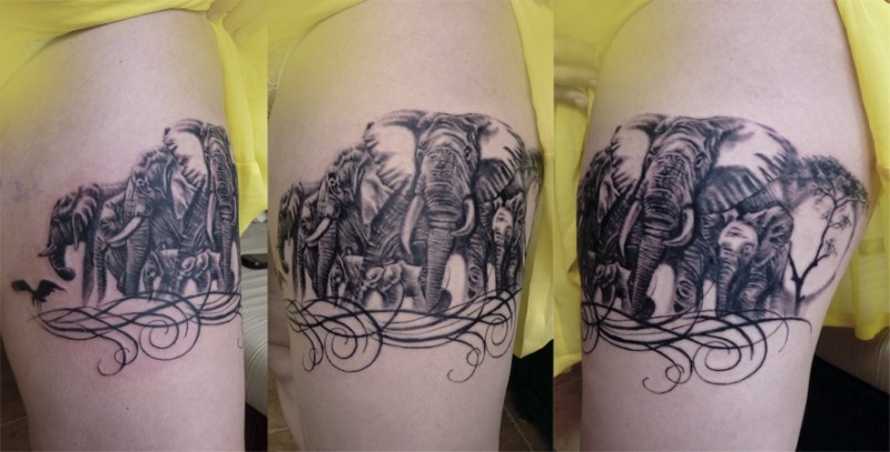 Detailed looking black ink shoulder tattoo of big elephant family