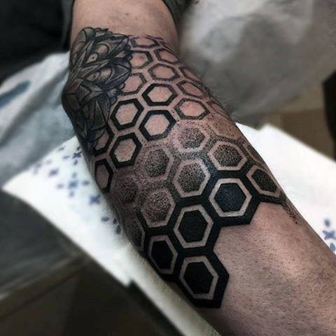 Dot style black ink arm tattoo of geometrical figures combined with flower