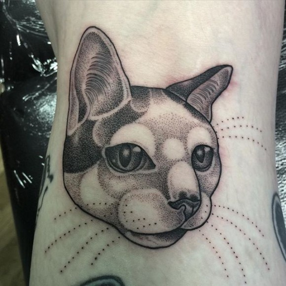 Dot style black ink tattoo of cute cat face