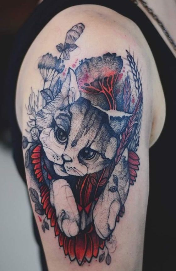 Dot style colored upper arm tattoo of cat with flowers and leaves by Joanna Swirska