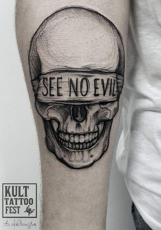 Dot style creepy looking arm tattoo of human skull with lettering