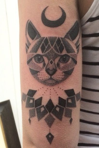 Dot style nice painted arm tattoo of cat with nice ornaments and moon symbol
