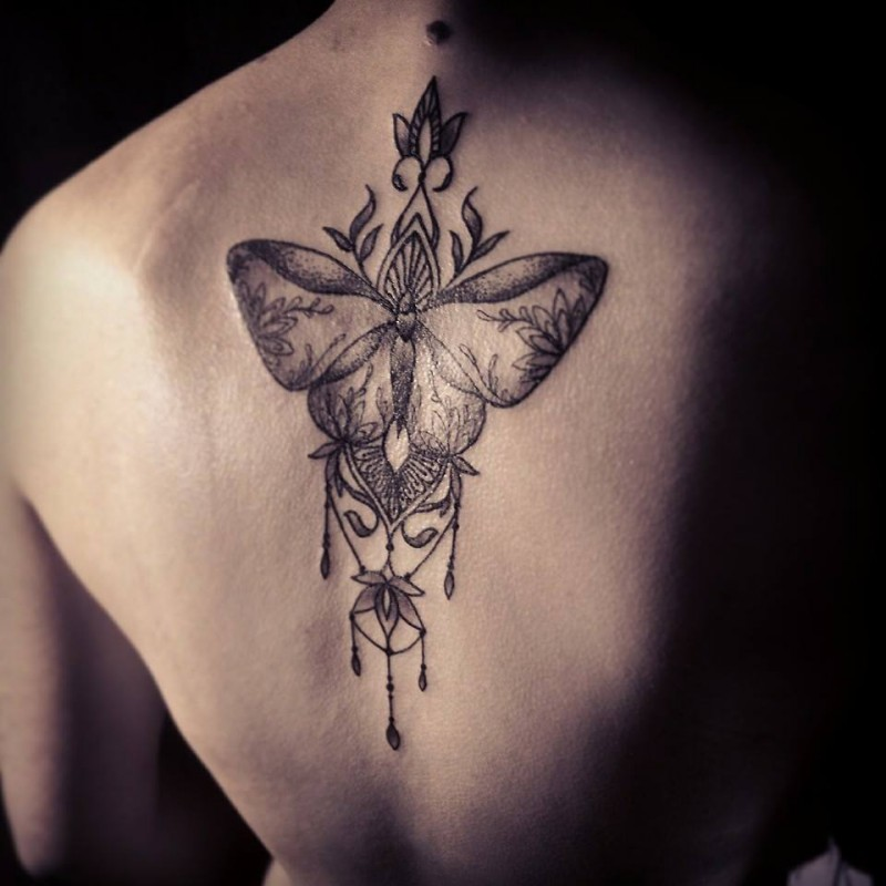 Dot style painted by Caro Voodoo back tattoo of big butterfly designed with flowers