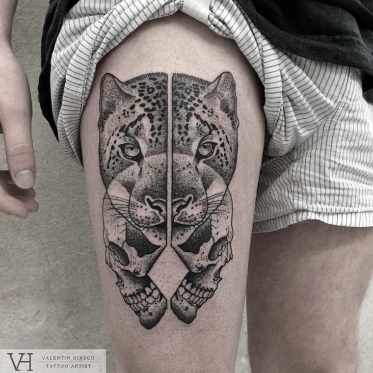 Dot style typical designed by Valentin Hirsch thigh tattoo of split leopard and human skull