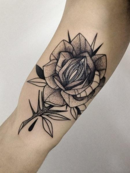 Dotwork style cool looking biceps tattoo of of small rose by Michele Zingales