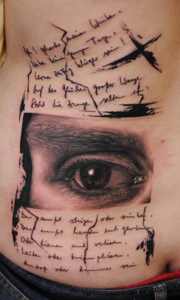 Dramatic designed black ink big lettering with sad eye tattoo on hip