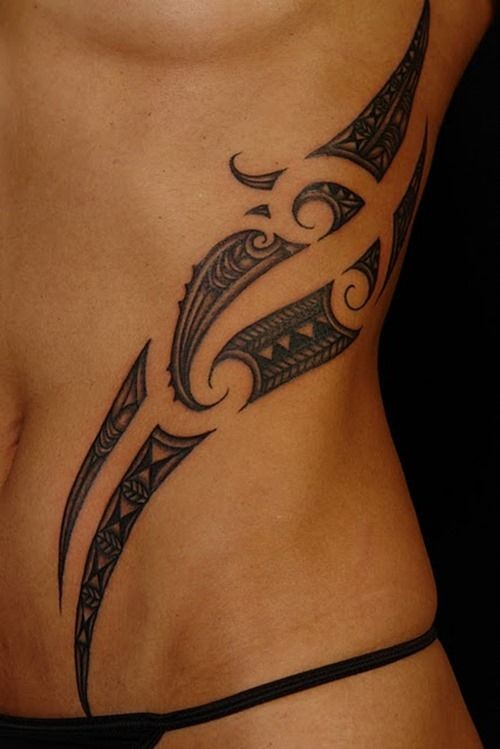 Elegant black polynesian tattoo on ribs