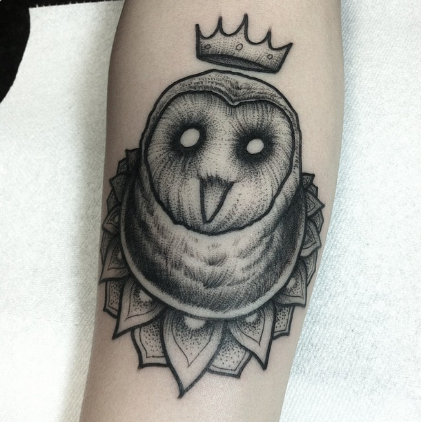 Engraving style black ink arm tattoo of owl with crown