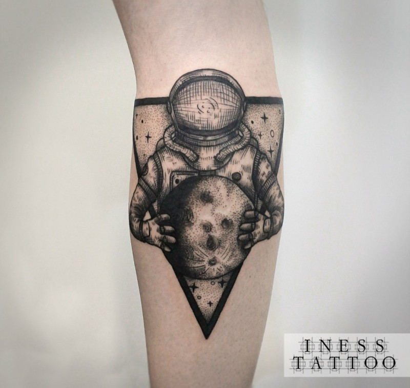Engraving style black ink arm tattoo of astronaut with moon and triangle