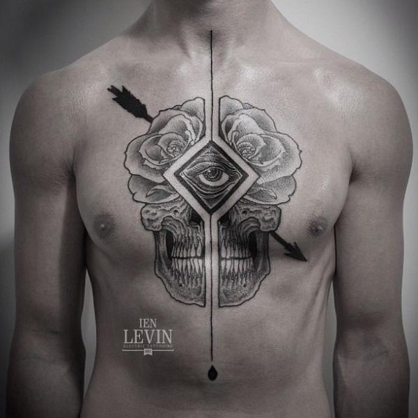 Engraving style black ink chest tattoo of interesting ornament stylized with human skull part and arrow