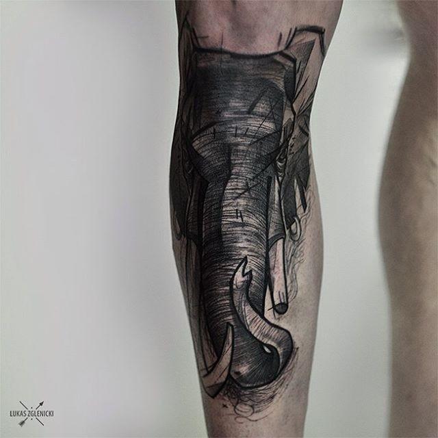 Engraving style black ink leg tattoo of detailed elephant