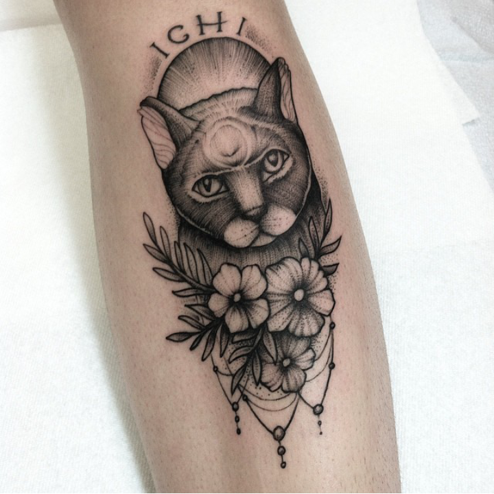 Engraving style black ink leg tattoo of stunning cat with flowers and lettering