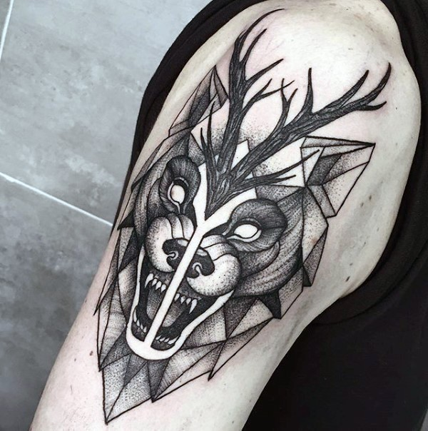 Engraving style black ink shoulder tattoo of evil wolf and deer