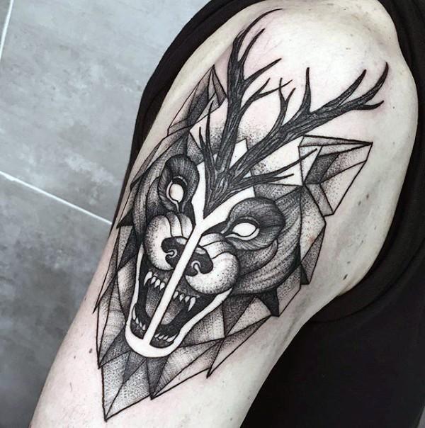 Engraving style black ink shoulder tattoo of evil wolf and deer