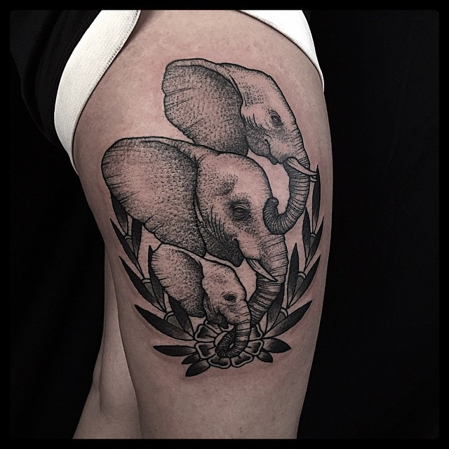 Engraving style black ink thigh tattoo of elephant family