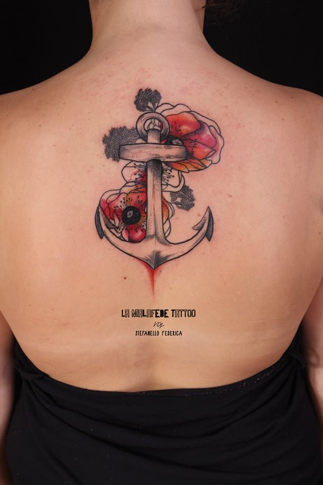 Engraving style colored anchor tattoo of back with flowers