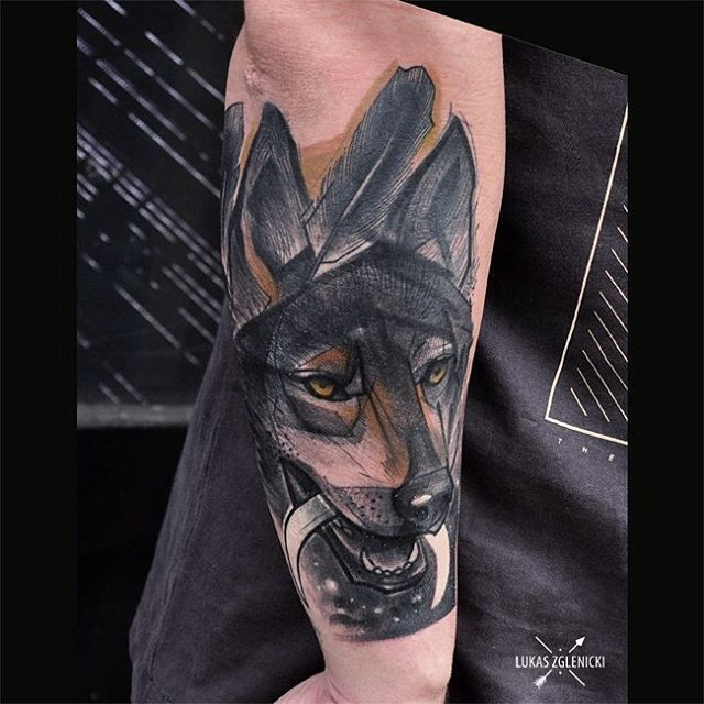 Engraving style colored arm tattoo of dog with moon