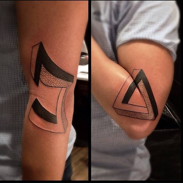 Engraving style mystical symbol tattoo on elbow