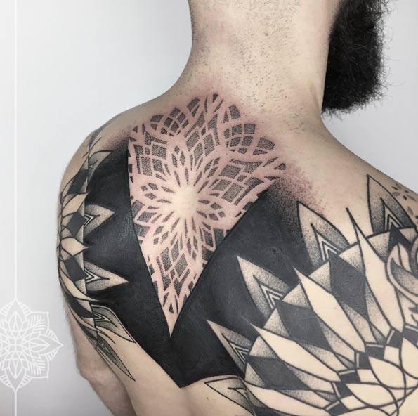 Enormous blackwork style upper back tattoo of creative ornament