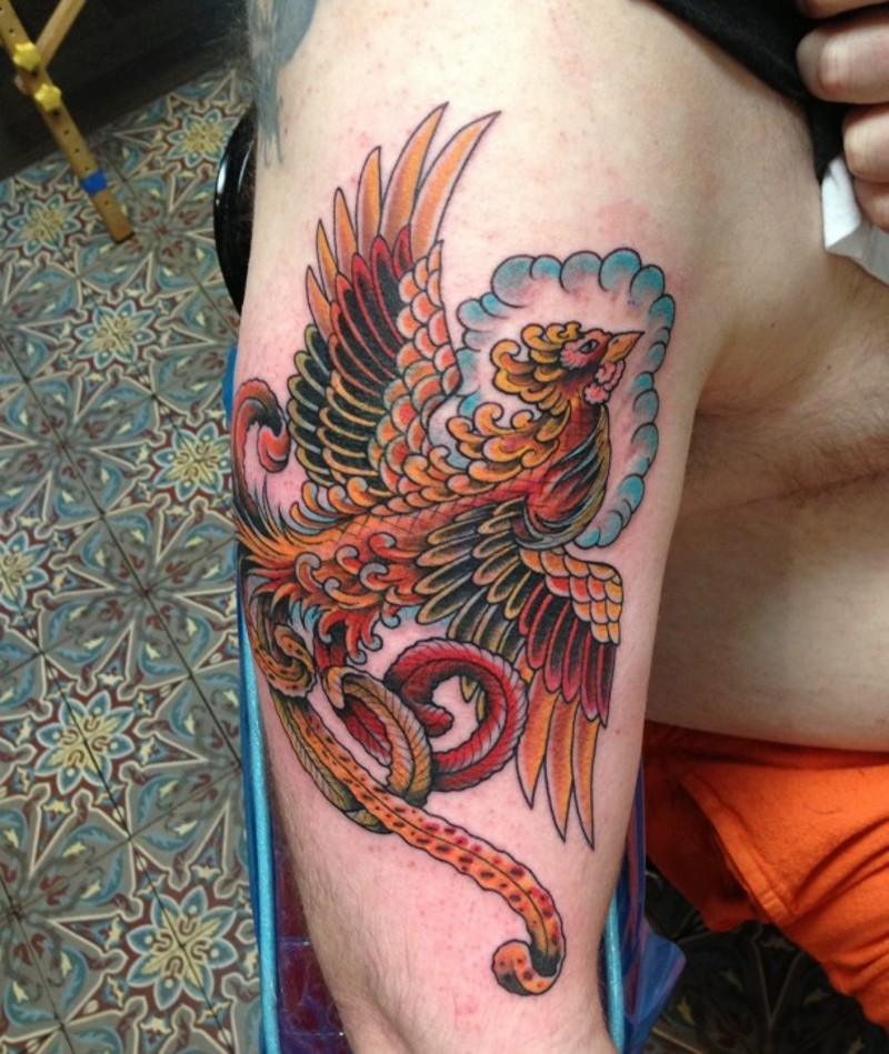Fairy flying Phoenix bird multicolored shoulder tattoo in old school style