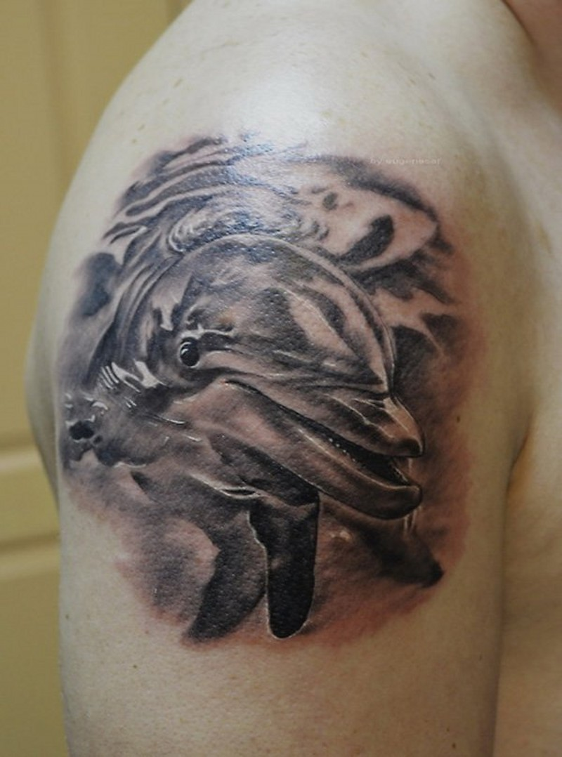 Fantastic very detailed big black and white dolphin tattoo on arm top