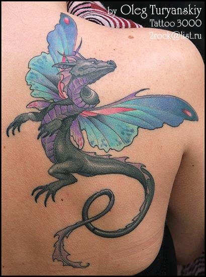 Fantasy like colored shoulder tattoo of dragon with fairy wings