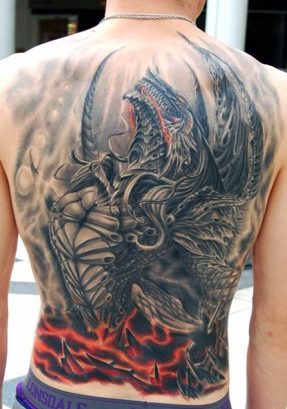 Fantasy style big impressive looking whole back tattoo of evil dragon
